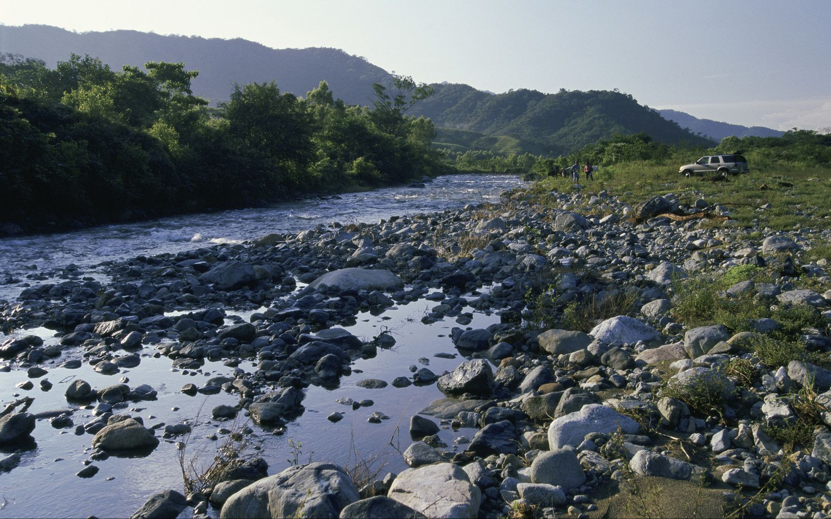 A river flows west off the Sierra Madre watershed through the agricultural community of Vienes Comunales San Antonio towards Pijijiapan and the Pacific ocean; Chiapas, Mexico