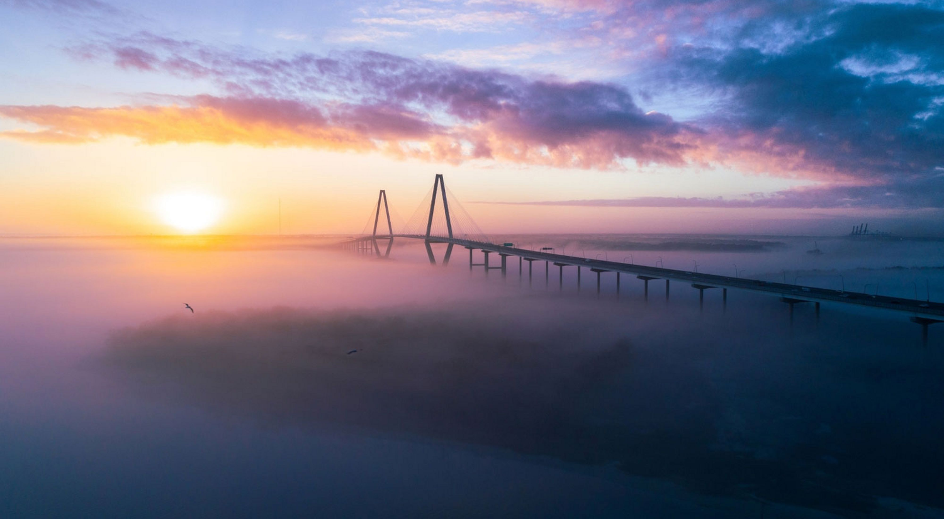 Sea fog covered the water below the Ravenel bridge during a chilly sunrise in Charleston, SC in February 2018.