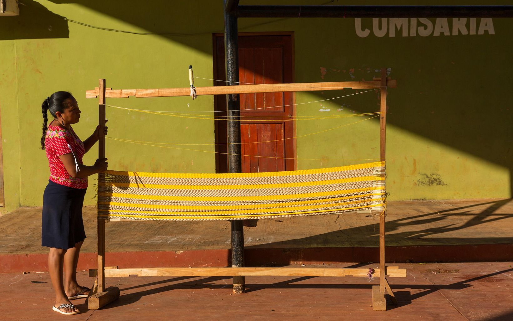 Rita Margarita Canul Ek of the women's hammock weaving cooperative that work every Friday under the covered basketball court in the ejido of San Agustin. The Nature Conservancy works with landowners, communities, and governments in Mexico to promote low-carbon rural development through the design and implementation of improved policy and practice in agriculture, ranching, and forestry. The Conservancy is leading the initiative, Mexico REDD+ Program in conjunction with the Rainforest Alliance, the Woods Hole Research Center, and Espacios Naturales y Desarrollo Sustentable.