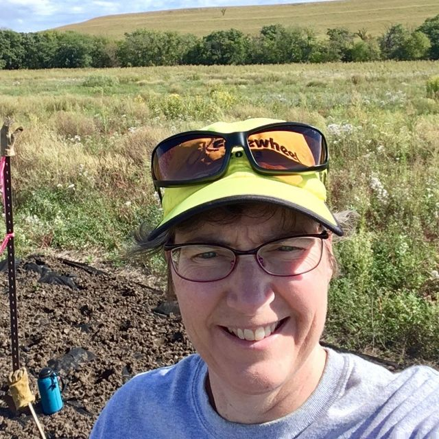 Michele volunteers to coordinate the Prairie Stewards. Here she takes a selfie while working at Tallgrass Prairie National Preserve.