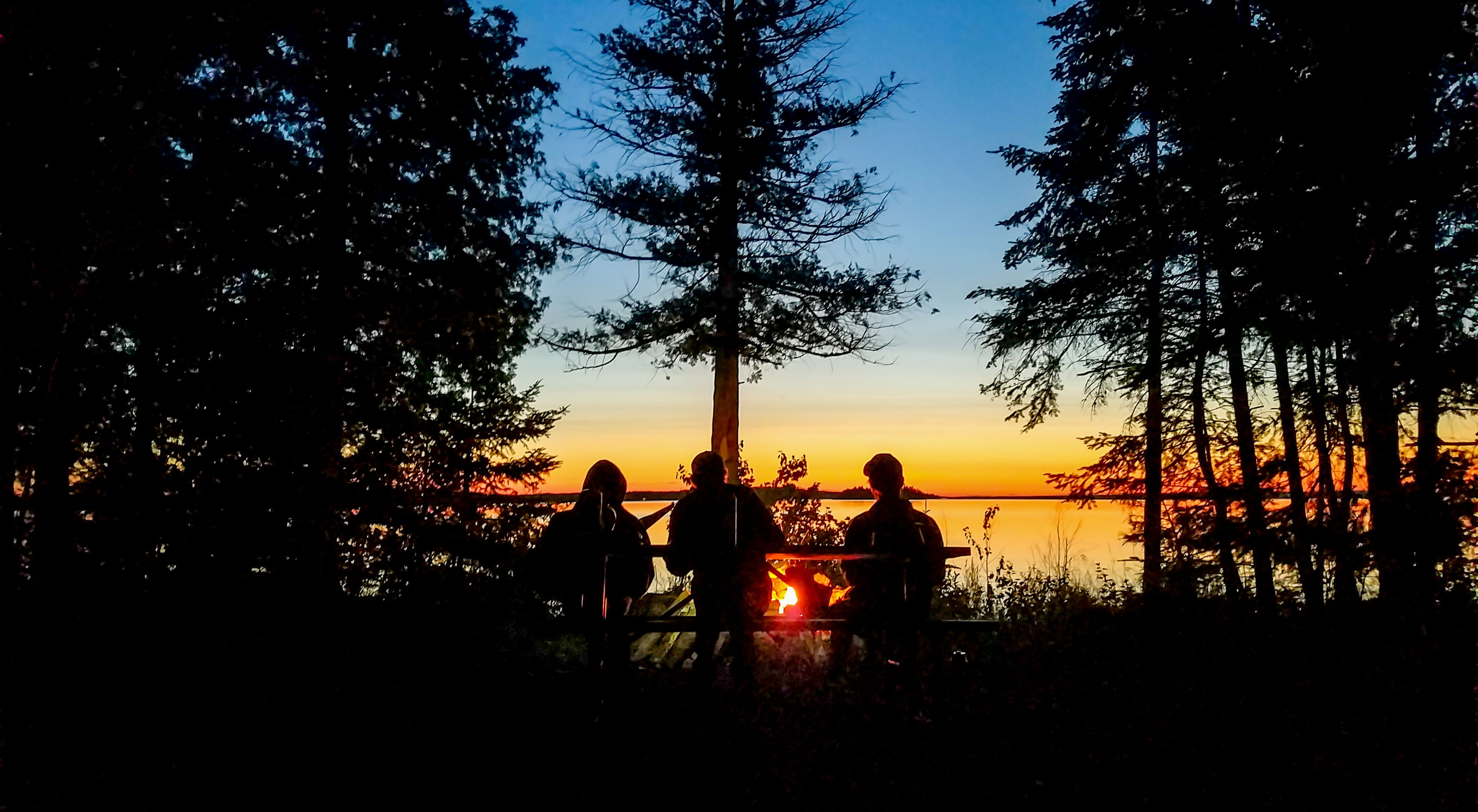 (ALL RIGHTS GRANTED TNC, CREDIT MANDATORY) TNC Roving Crew watching the sunset on Drummond Island.   Photo Credit: © Kim Steinberger/The Nature Conservancy
