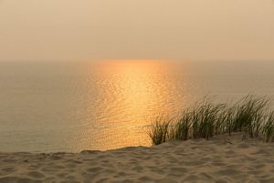 View of Lake Michigan sunset at top of a sand dune