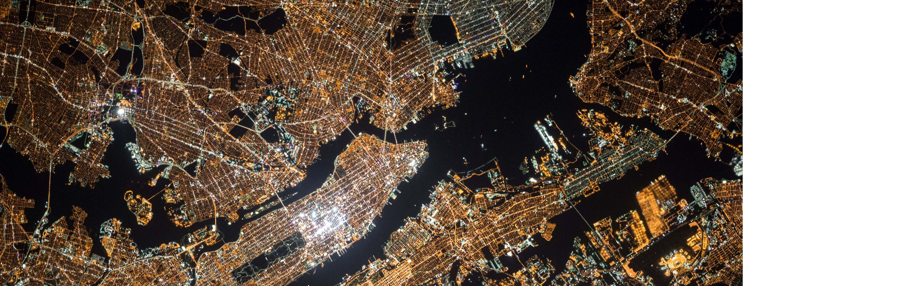 Aerial view of a city grid at night.