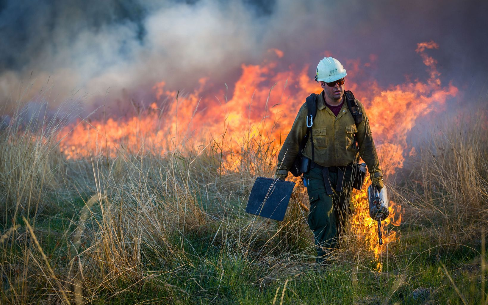 Weston Toll lighting fire with a drip torch on Loup Farm in Willamette Valley, Oregon. In October 2015, the Nature Conservancy's Southern Rockies Wildland Fire Module traveled to the Willamette Valley in Oregon for three weeks to help the Oregon chapter and other local stakeholders (including US Fish & Wildlife, US Forest Service, and BLM) with prescribed burns of the grassland prairies and oak savannas. Burns ranged from