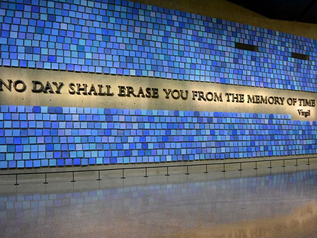 9/11 memorial wall with a quote from Virgil