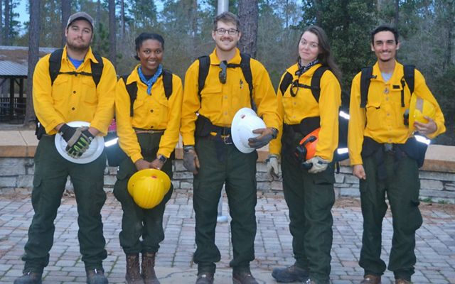 GulfCorps alum Simon Cruz Haggerty (far right) and his team during a controlled burn exercise.