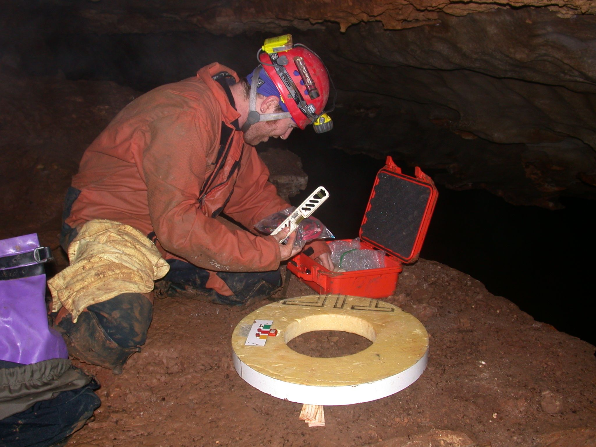 Researcher recording audio inside the cave.