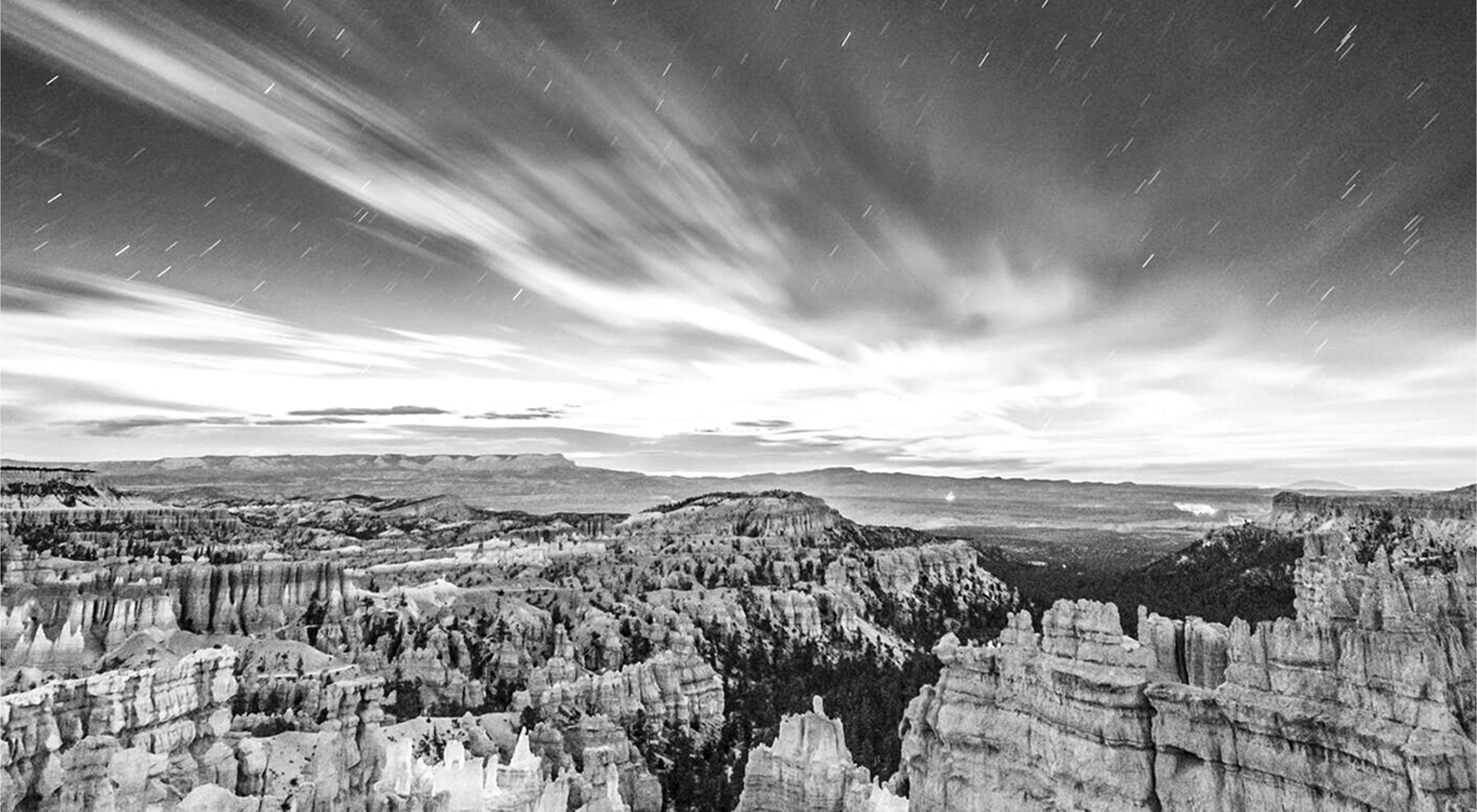 Black and white image of the moonrise over Bryce Canyon National Park in Utah.