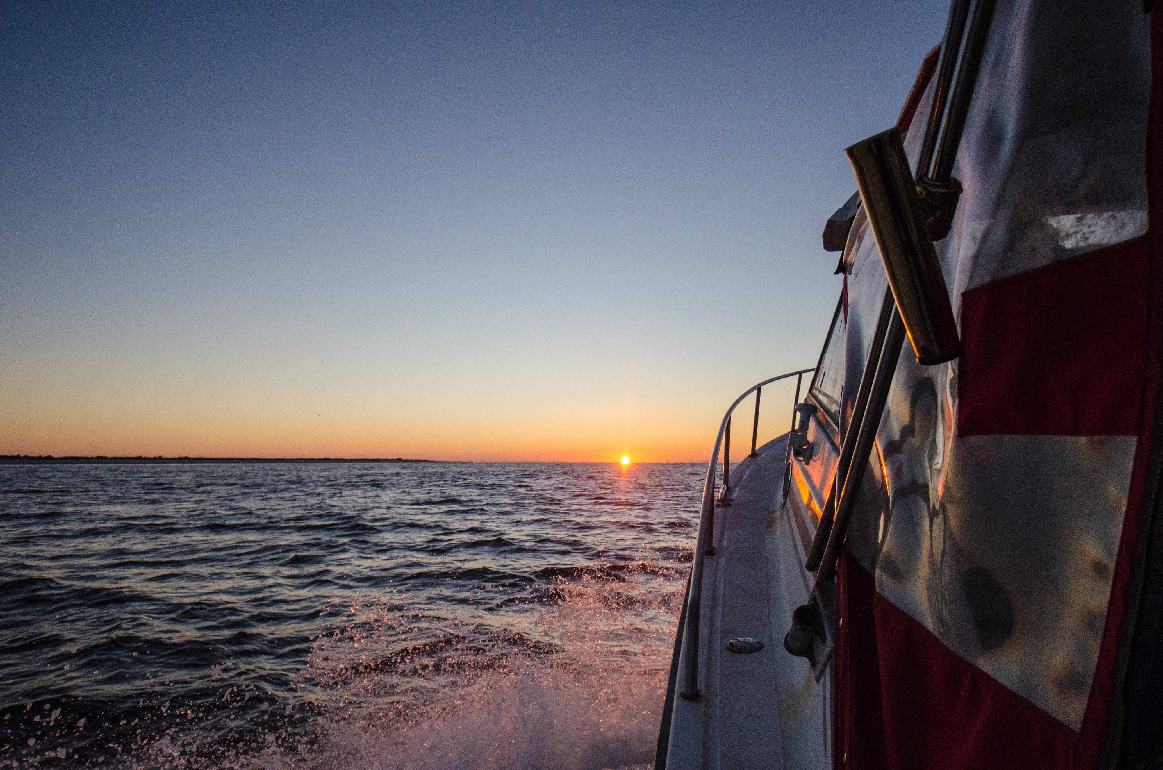 sunrise seen from fishing boat