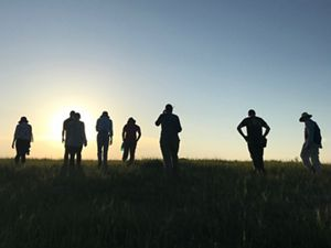 Members of the science team touring a prairie.