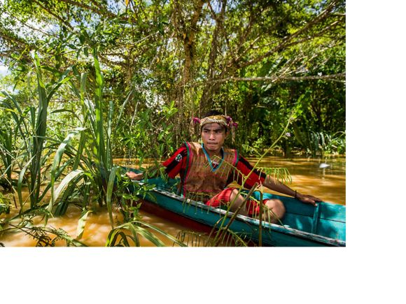 A local resident canoeing in East Kalimantan, Indonesia.
