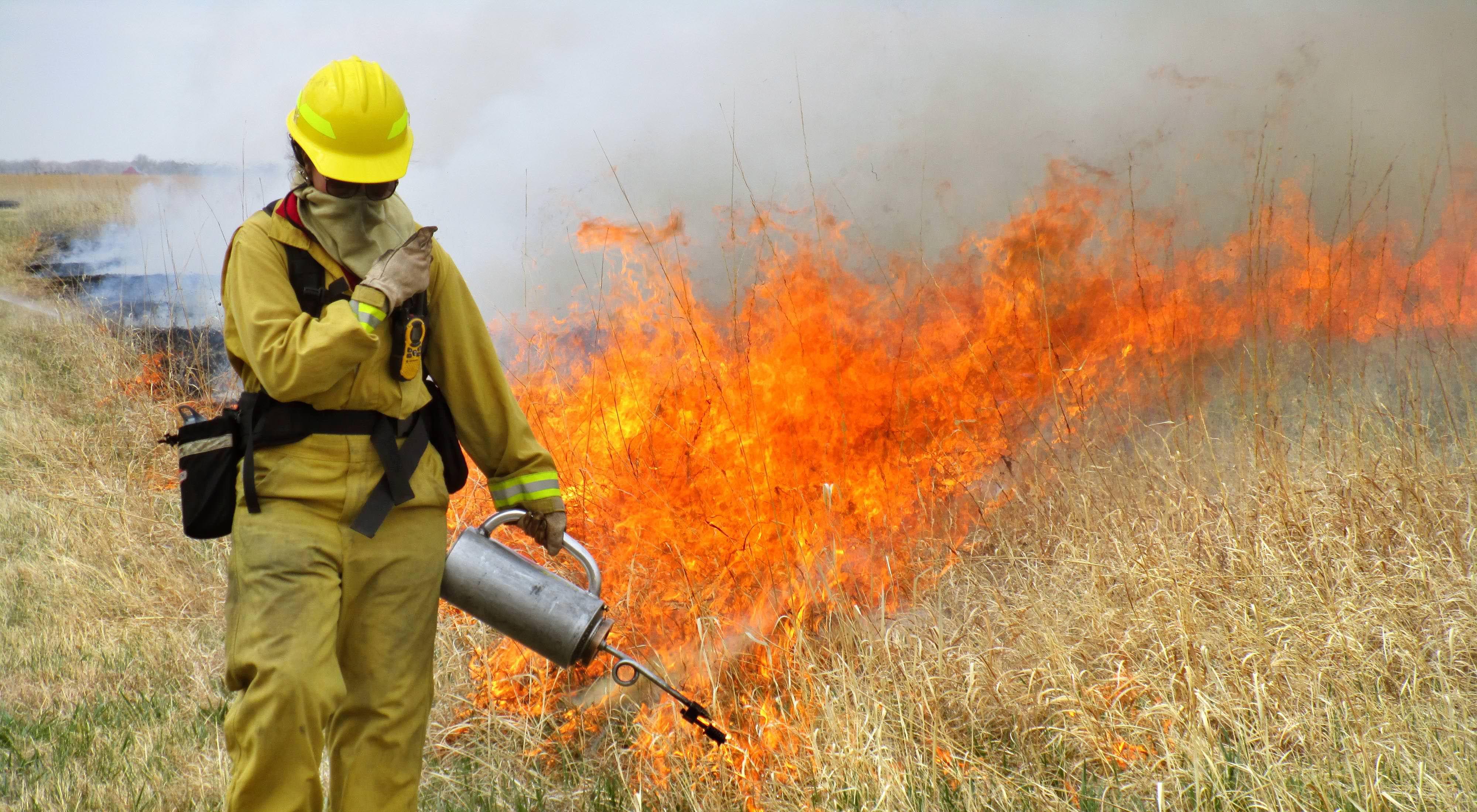 Prescribed fire at TNC Caveny tract.  Platte River Prairies, Nebraska.  Eliza Perry igniting. Photo credit: © Chris Helzer/TNC