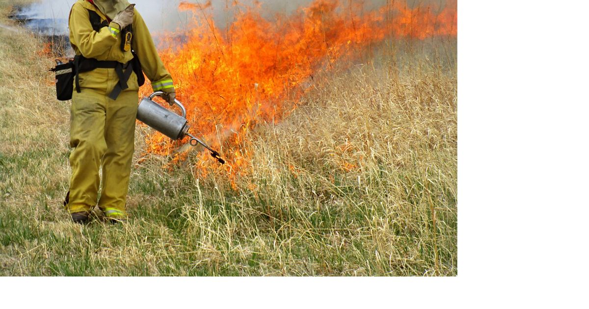 Prescribed fire at TNC Caveny tract.  Platte River Prairies, Nebraska.  Eliza Perry igniting. Photo credit: © Chris Helzer/TNC