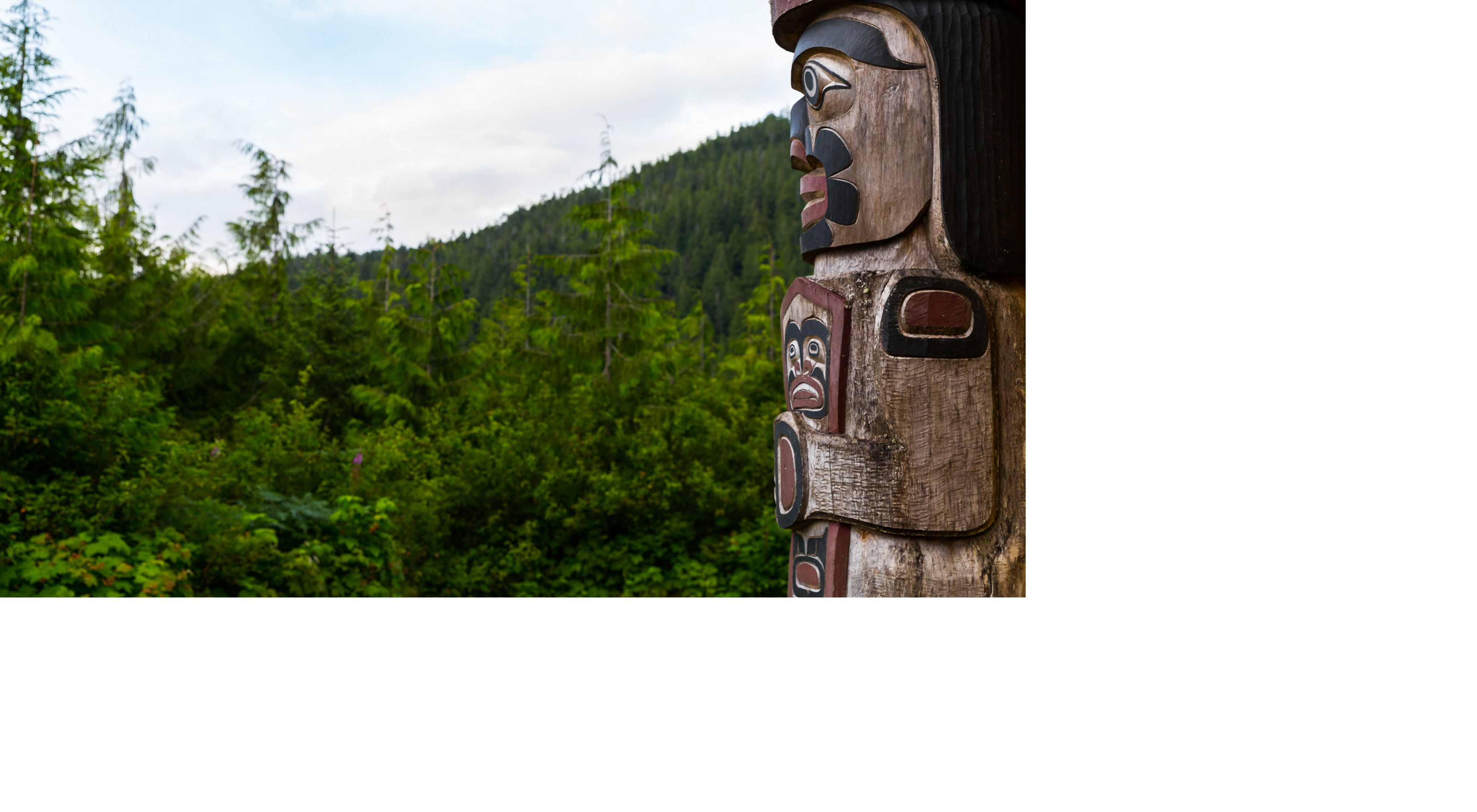 The Watchman Totem Pole guards the Big House and watches over the village of Klemtu from in front of the Kitasoo/Xai'xais Big House in Klemtu, British Columbia