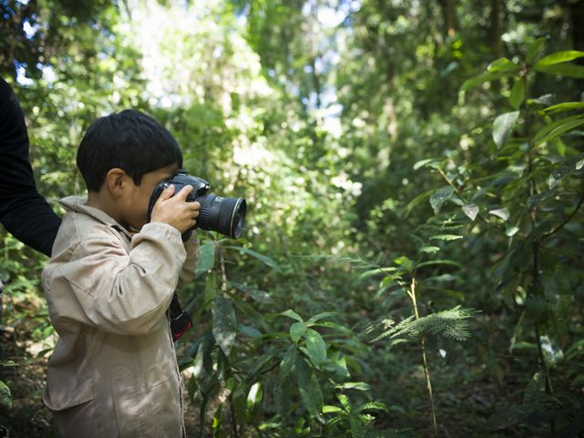 A school boy from Chaihuin Village school uses a camera to take pictures of different plants as part of a forest ecology field trip into the Valdivian Coastal Reserve.