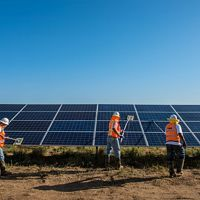 Workers clean solar panels for maximum efficiency at the power solar facility in Lancaster, California.