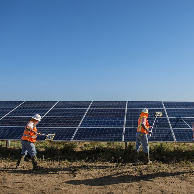 Worker's clean solar panels for maximum efficiency at the power solar facility in Lancaster, California. Photo credit: © Dave Lauridsen