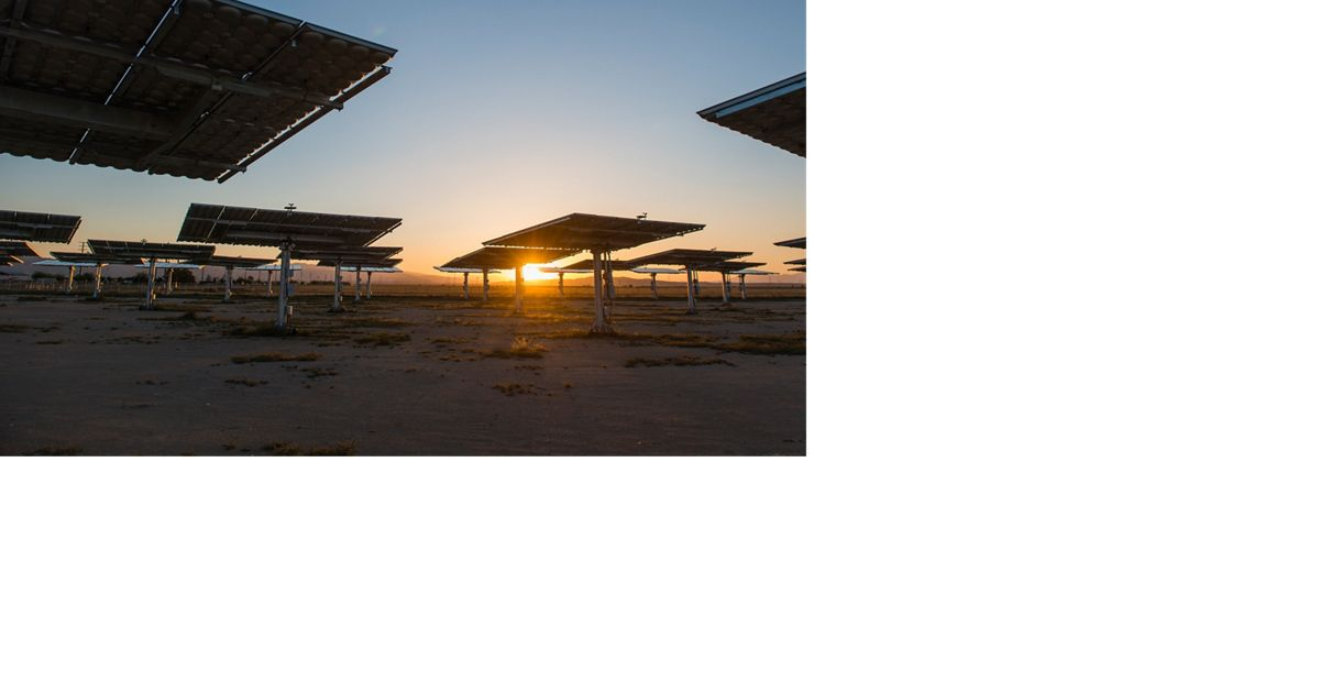 The sun rises at a solar facility in California.