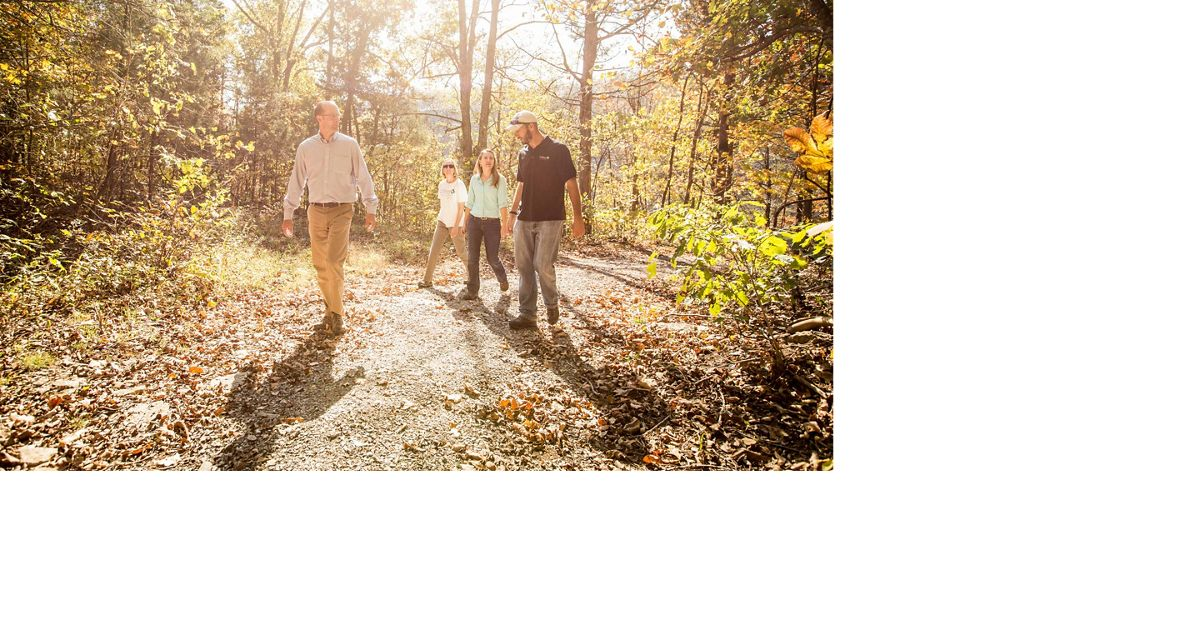 Hikers at a preserve on a sunny autumn day