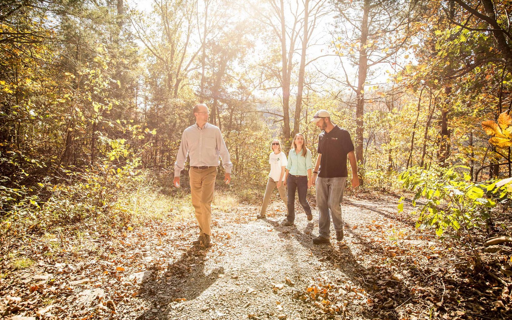 Members of TNC's Kentucky staff take a walk at the Dupree Nature Preserve during autumn.