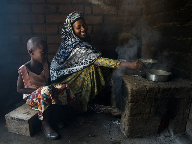 woman cooking on outdoor stove