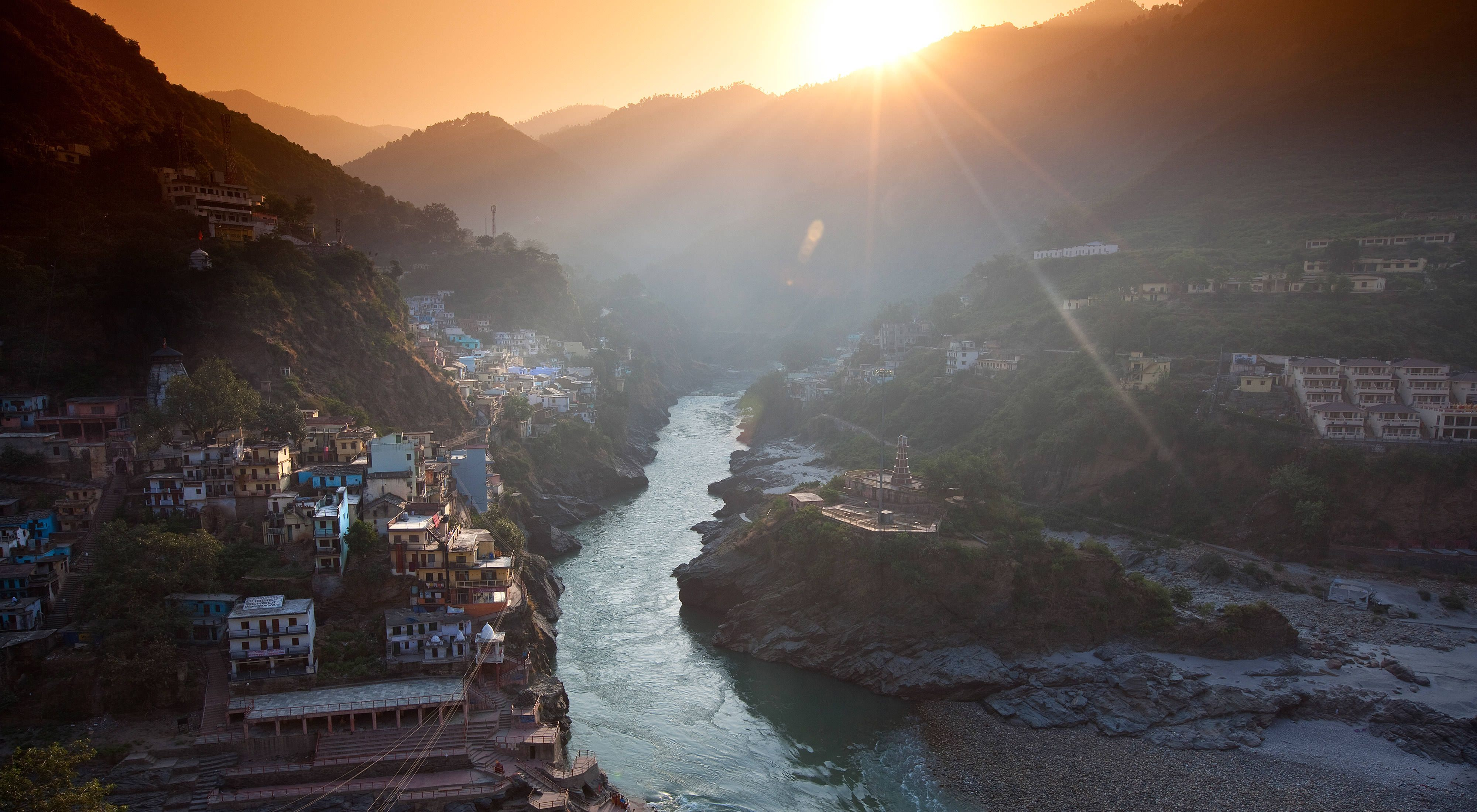 Villages line the sides of the Ganges River with the sunset