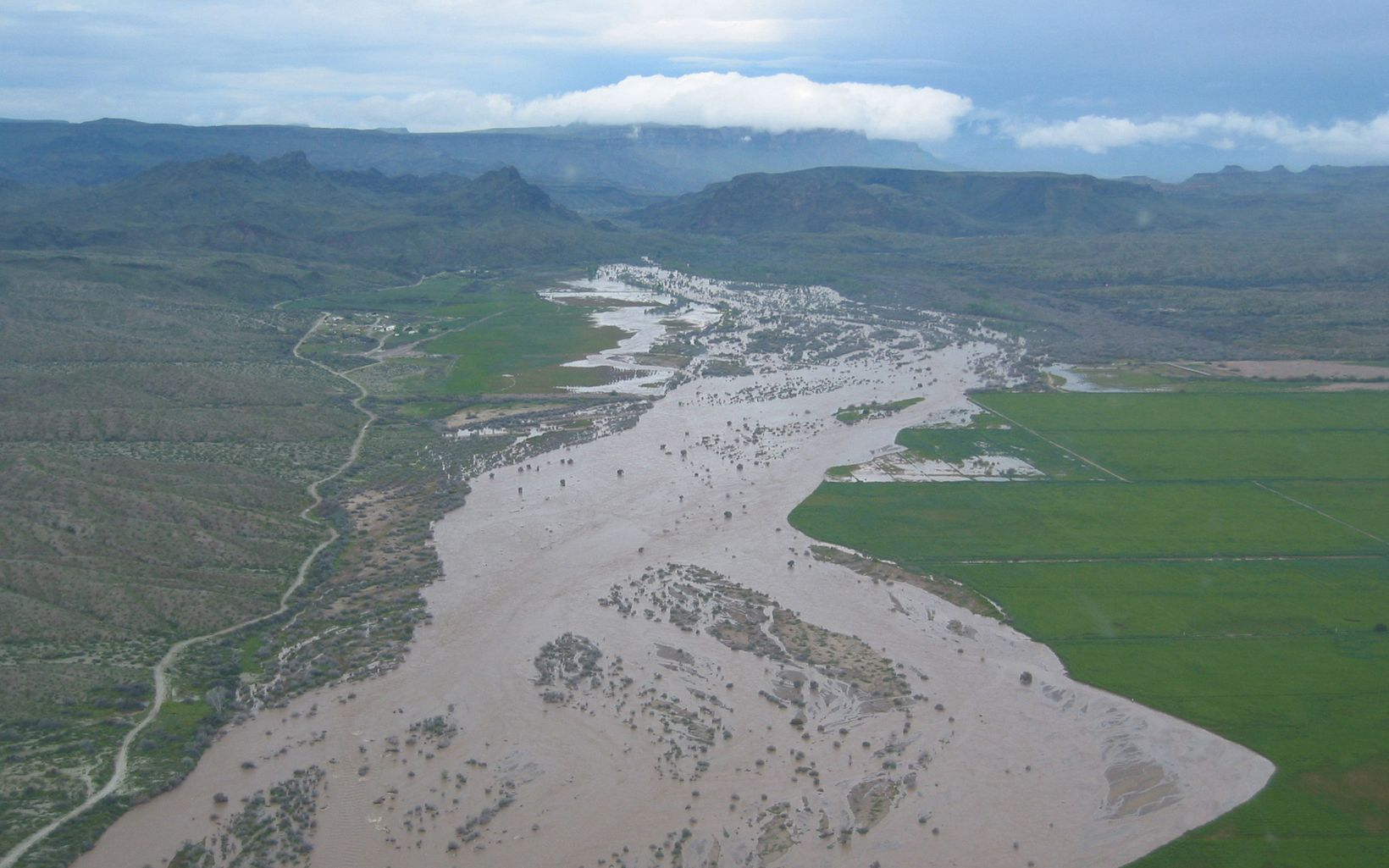 Aerial view of a wide, muddy river in Arizona.