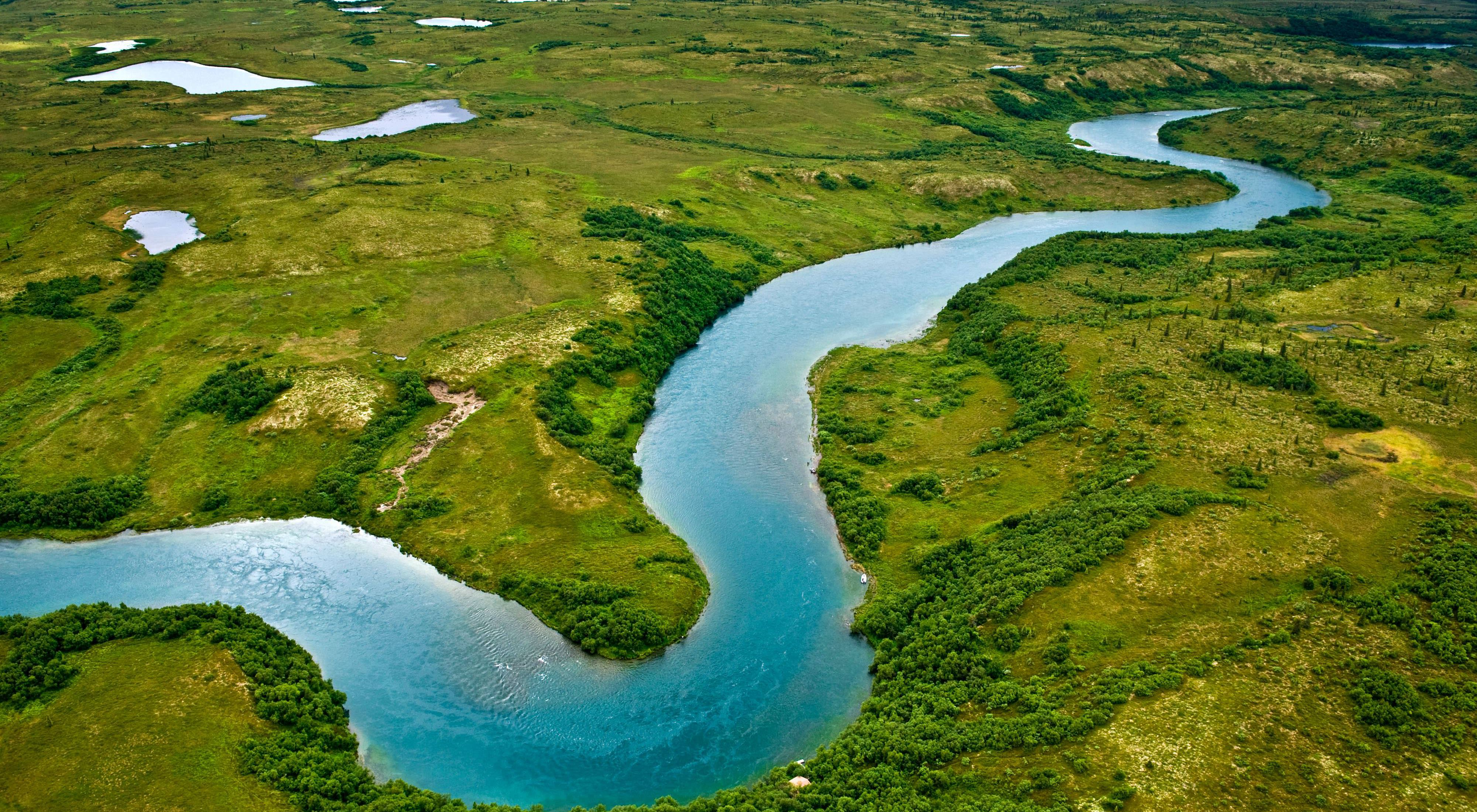 Aerial photo of a river winding through countryside.
