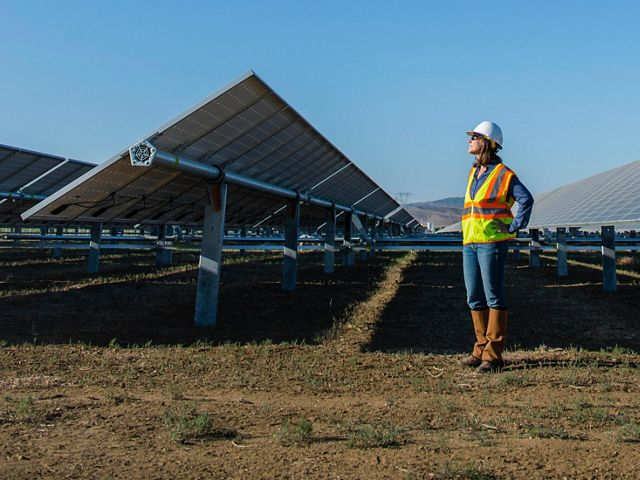 The Conservancy's Laura Crane visits a solar project under construction.