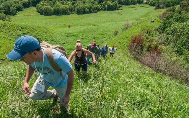 Group of hikers making their way to a high point in the Loess Hill of Iowa that is home to tremendous diversity of plants and animals which are resilient to climate change.