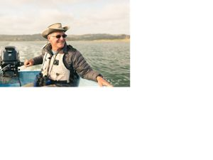 (ALL INTERNAL RIGHTS, LIMITED EXTERNAL RIGHTS) May 2015. Longtime Elkhorn Reserve volunteer Ron Eby captains a research boat to collect data on sea otters in Elkhorn Slough, California. Elkhorn Slough is the second-largest remaining salt marsh in California and hosts a tremendous diversity of plant and animal life. This rich habitat has been held together by decades of collaborative conservation. Photo credit: © Kiliii Yuyan