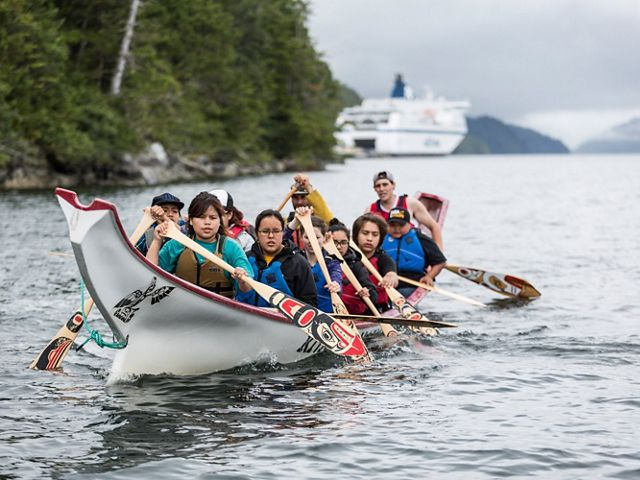 Students paddle a traditional canoe near Klemtu, Canada