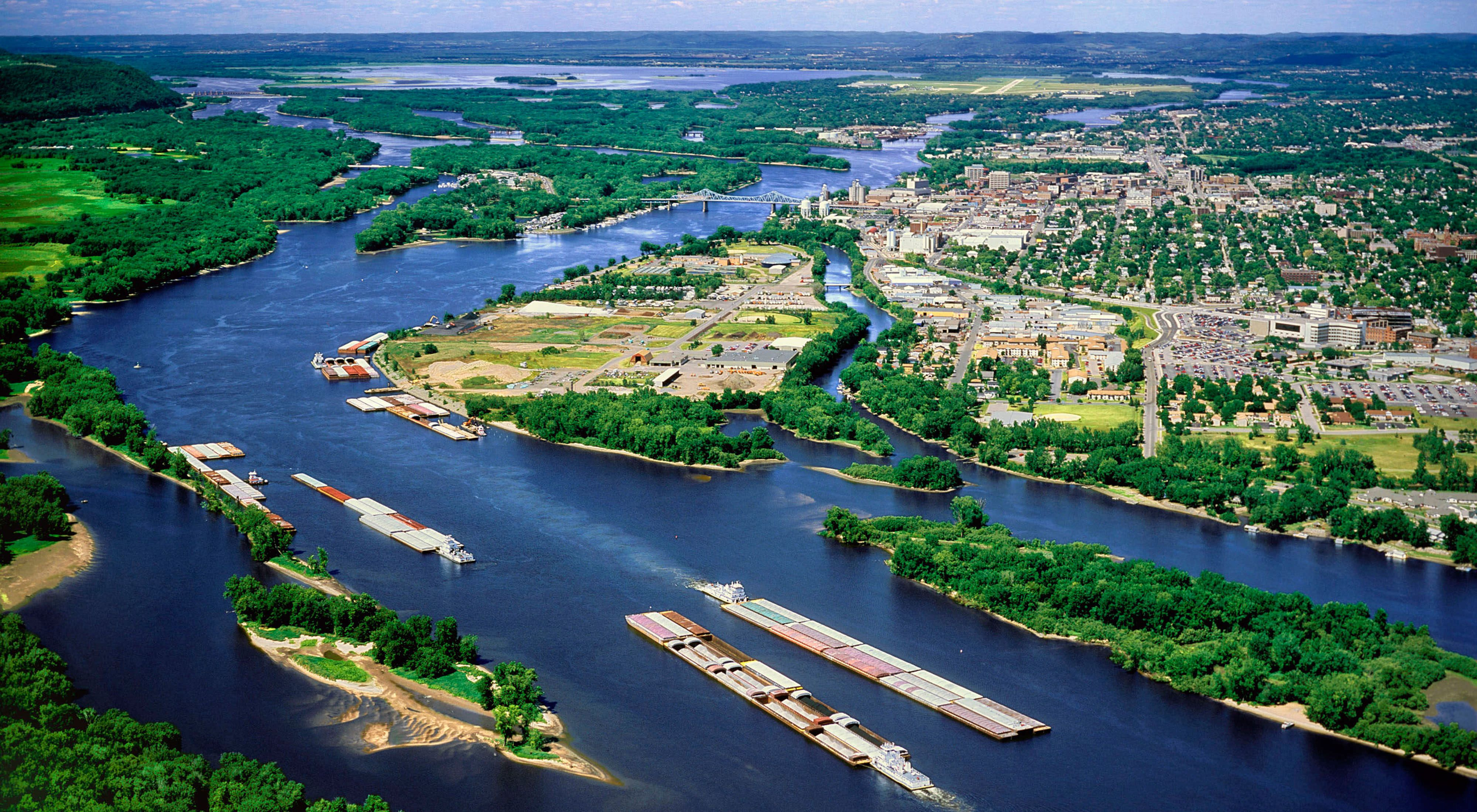 Three barges in Pool 8 of the Mississippi River at LaCrosse, Wisconsin. More than half the goods consumed by U.S. citizens are produced with water from the Mississippi.
