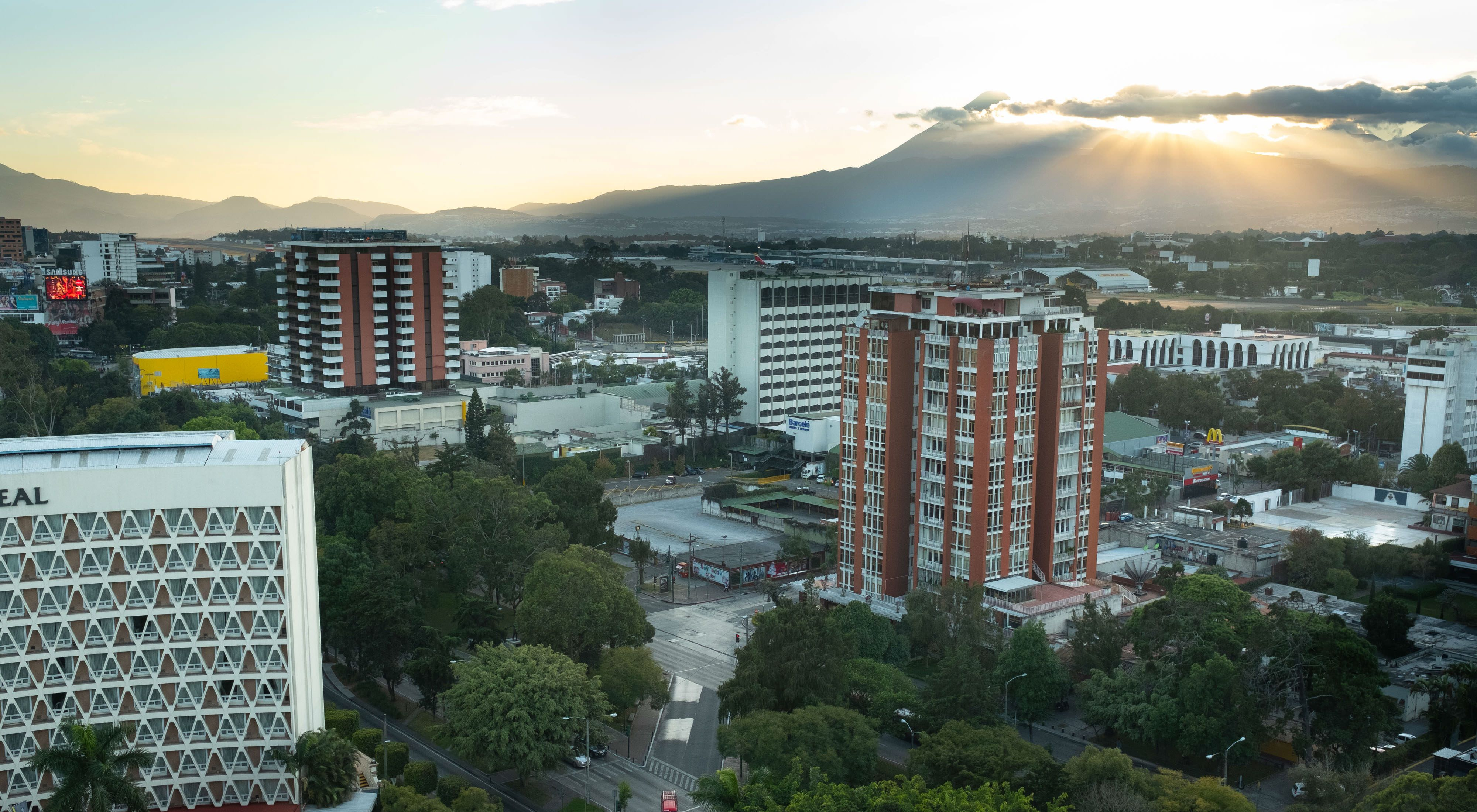 Urban views of central Guatemala City as seen from a top floor window in a building. Zone 10, Guatemala City, Guatemala. December 2017. TNC's Guatemala City Water Fund Project