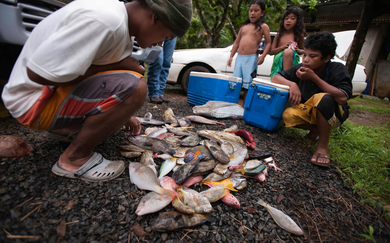 Members of the Paulino family examine their catch some of which they will sell to other members of their village community.