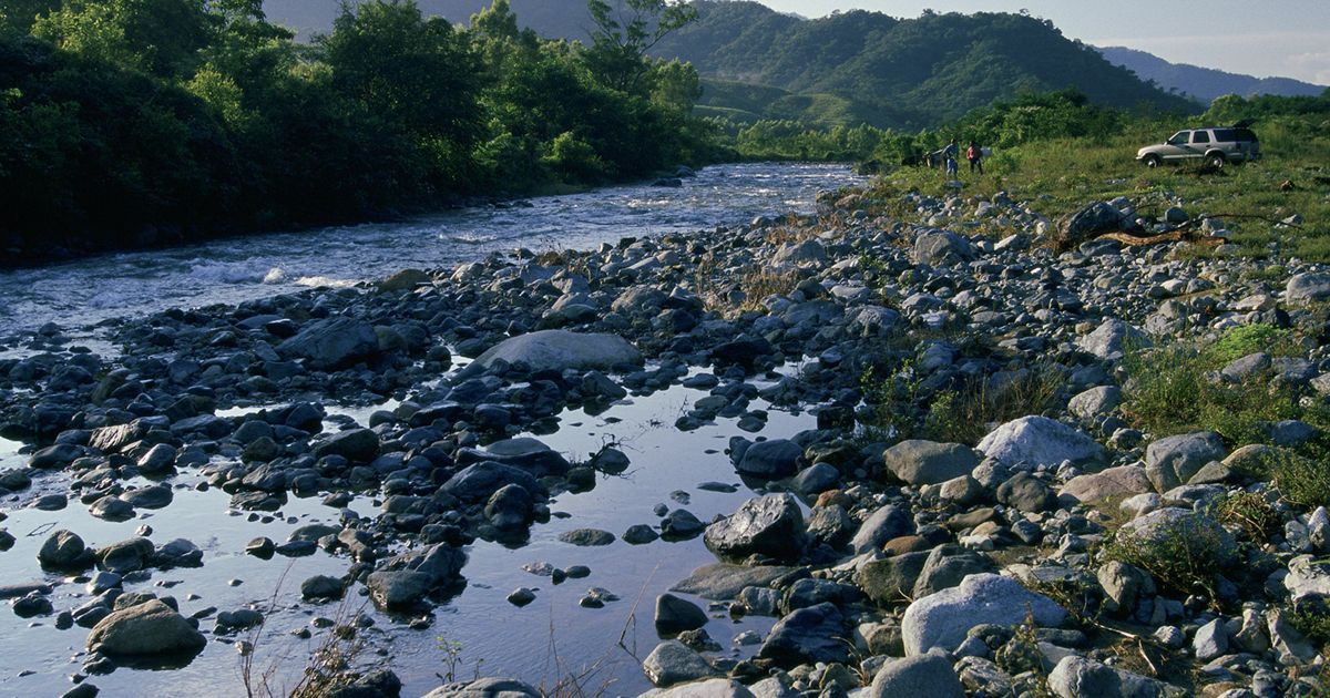 A river flows west off the Sierra Madre watershed through the agricultural community of Vienes Comunales San Antonio towards Pijijiapan and the Pacific ocean; Chiapas, Mexico.