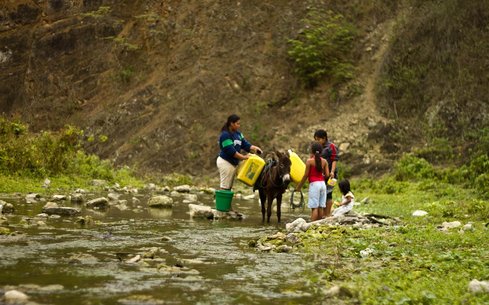 Women collect water in the Ayampe River in Ecuador's Manabí Province.