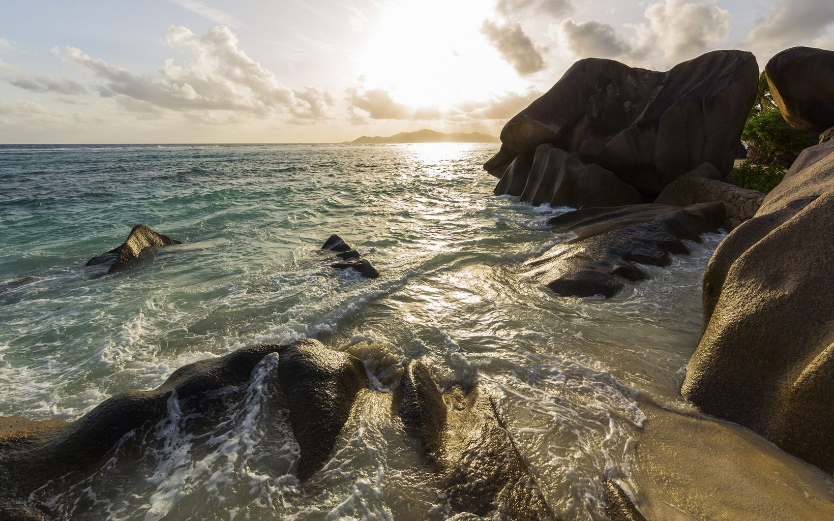 in the surf and sand define the coastlines of Seychelles's inner islands.