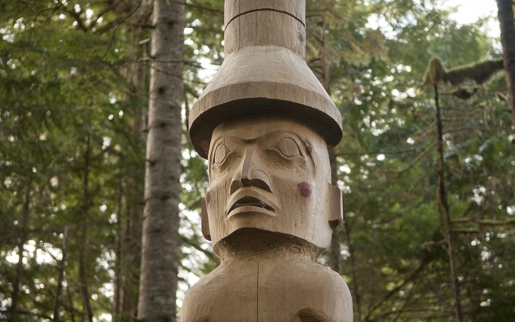 A carved mortuary pole erected by the Heiltsuk people to the memory of their late tribal elder, Thistalalh (Edward) Martin, stands on traditional Heiltsuk lands along the Koeye River in the Great Bear Rainforest of British Columbia, Canada.