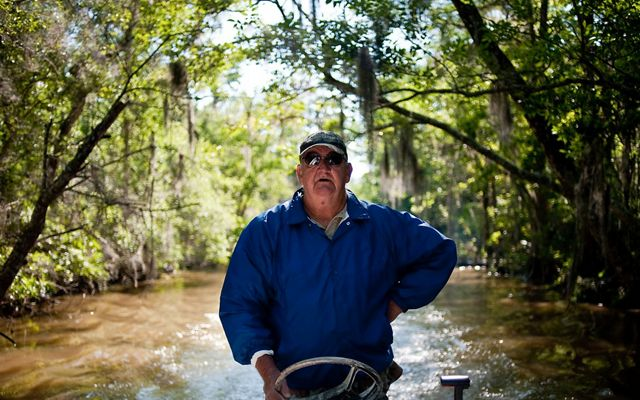 James Holland, a riverkeeper and retired crabber, drives a motorboat.
