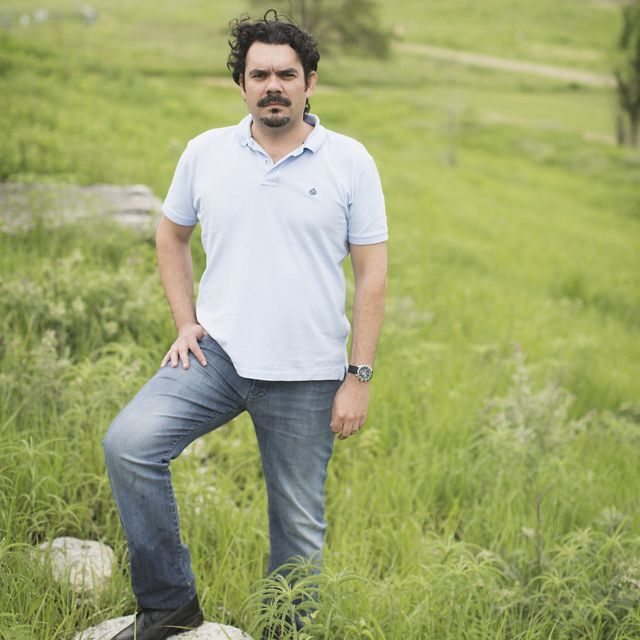 Leandro Baumgarten, Lead Scientist for the Conservancy's work in Brazil including the extensive grasslands of the Cerrado which have over 10,000 species of plants and feeds three of the major water basins in South America. Here he stands at the Konza Prairie Biological Station in Manhattan, Kansas.