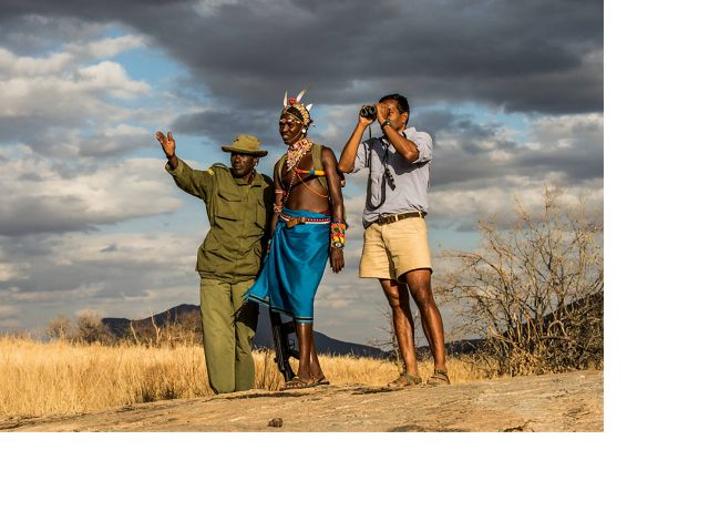 A Nature Conservancy scientist walks with a guide and ranger inside Northern Rangelands Trust Sarara conservancy in Northern Kenya.