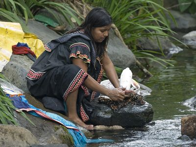 A woman washes clothing