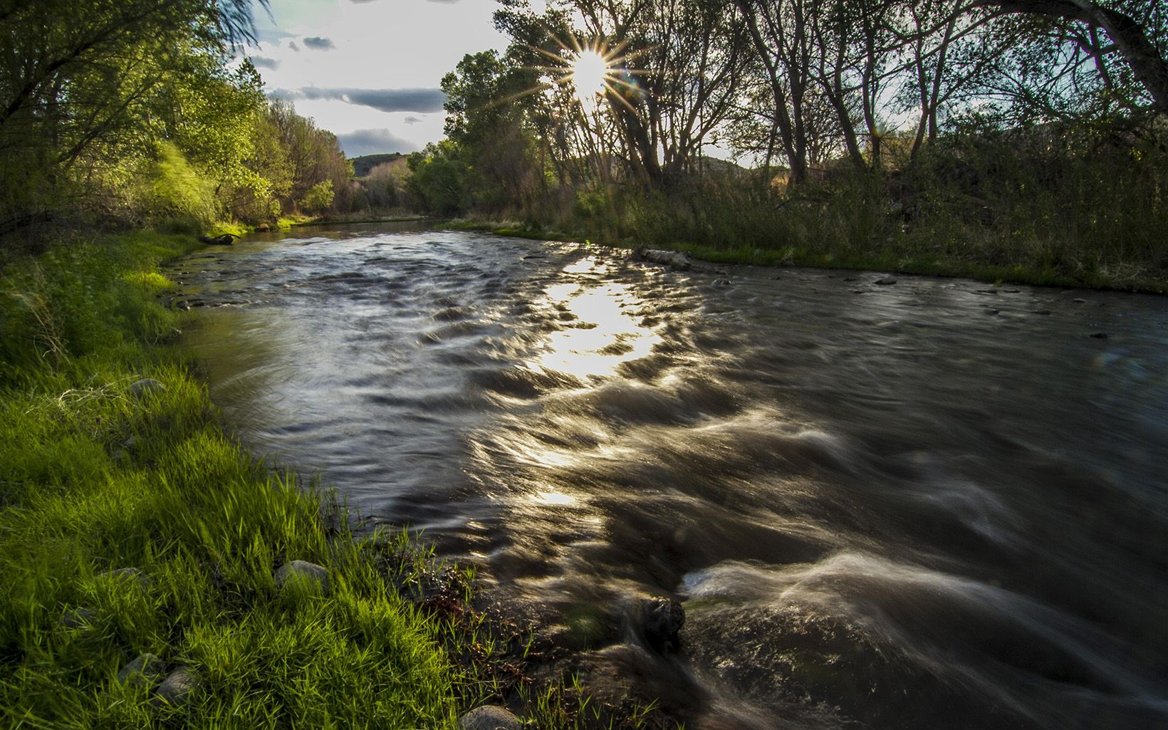Fast-flowing river at sunset.