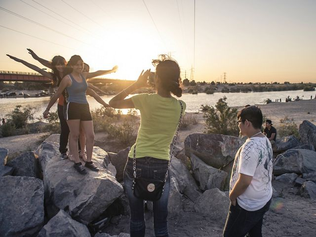 Local residents in San Luis, Mexico, snap photos as the Colorado River flows past their town for the first time in decades.