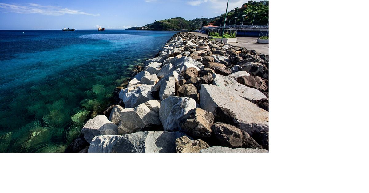 side view of a seawall with gray rocks