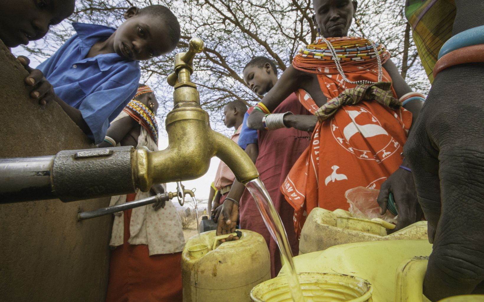 Samburu women collect water from a well built by Northern Rangelands Trust and the Nature Conservancy at the West Gate Conservancy in Northern Kenya.  The Samburu people are pastoralists, whose livelihoods have traditionally been rooted in semi-nomadic herding across the rangelands of northern Kenya, but pressures increase on natural resources, grazing cattle has become a volatile livelihood as unpredictable drought and competition with protected wildlife for grazing becomes more frequent.