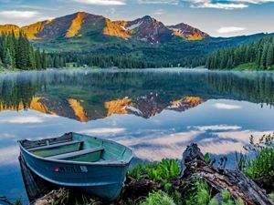 reflected in the mirror-like still waters of Lake Irwin, near Crested Butte, Colorado.