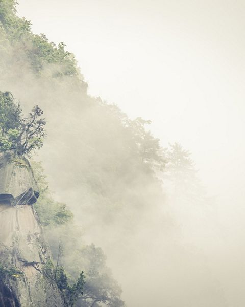 Misty mountain ridge in Laohegou Nature Reserve