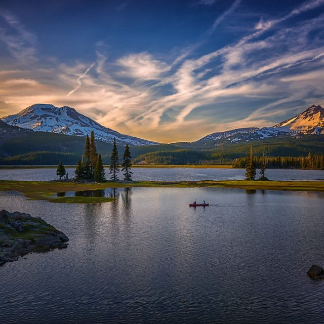 Evening Paddlers on Sparks Lake along the beautiful Cascade Lakes Scenic Byway in Bend, Oregon.